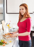 Woman making  omelette with eggs in home Royalty Free Stock Photo