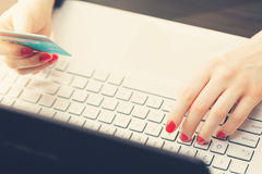 Woman making online payment with credit card. On laptop Royalty Free Stock Photography