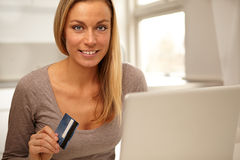 Woman Making An Online Purchase. Beautiful young woman Making An Online Purchase Royalty Free Stock Photography