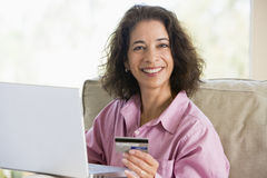 Woman making online purchase at home. Looking to camera Stock Photo