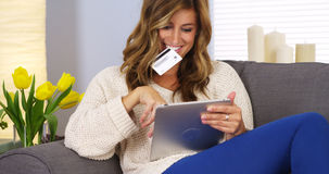 Woman making online purchase with tablet computer Royalty Free Stock Images