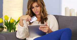 Woman making online purchase with tablet computer Royalty Free Stock Photography