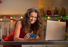 Woman making online shopping in decorated kitchen Royalty Free Stock Photos