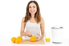 Woman making orange juice Stock Image
