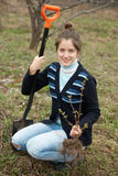 Woman making orchard with spade and sprouts Stock Images