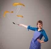 Woman making pancakes Stock Image