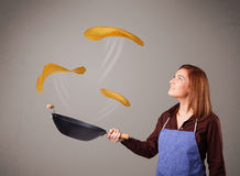 Woman making pancakes Stock Photography