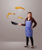 Woman making pancakes Stock Photos