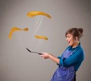 Woman making pancakes Royalty Free Stock Photography
