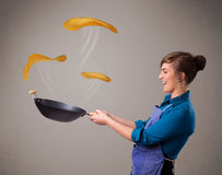 Woman making pancakes Royalty Free Stock Photos