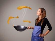 Woman making pancakes Royalty Free Stock Images