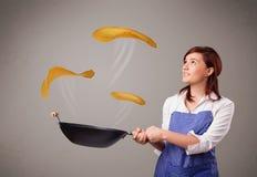 Woman making pancakes Royalty Free Stock Image