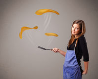 Woman making pancakes Stock Images
