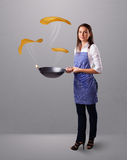 Woman making pancakes Stock Photo