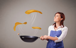 Woman making pancakes Stock Image