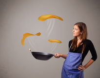 Woman making pancakes Royalty Free Stock Image