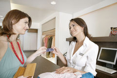 Woman Making Payment by Counter Royalty Free Stock Photo
