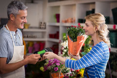 Woman making payment with her credit card to florist Stock Photo