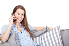 Woman making a phone call. Attractive young woman making a phone call Royalty Free Stock Photography