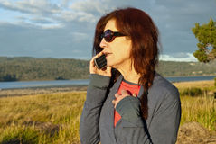 Woman making phone call in golden light Stock Photography