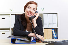 Woman making phone call in office Royalty Free Stock Photos