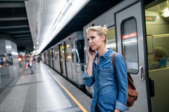 Woman making phone call at the underground platform Stock Photography