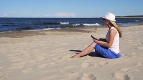 Woman making photo of her kids on the sea beach stock footage