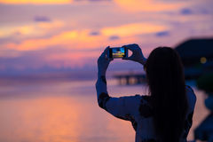 Woman making photo on her phone of beautiful Royalty Free Stock Photography