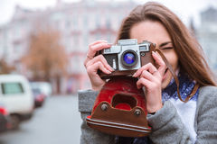 Woman making photo on retro camera Stock Photography