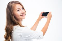 Woman making photo on smarptone Stock Image