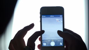 Woman making photos with smart phone from flying stock footage