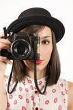 Woman making photos with vintage film camera Stock Images