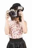 Woman making photos with vintage film camera Stock Photos