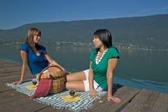 Woman making a picnic. At the edge of a lake Stock Photos