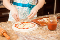 Woman making pizza at home Stock Photos