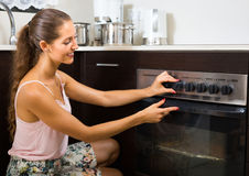 Woman making pizza at home Stock Photography