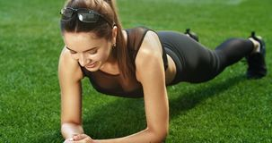 Woman Making Plank stock footage