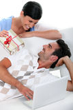 Woman making a present to her boyfriend Royalty Free Stock Images