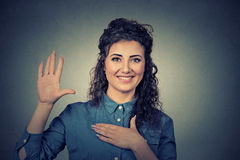 Woman making a promise Royalty Free Stock Photo