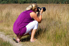 Woman is making photograph Stock Images