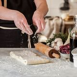 A Woman Making Puff Pastry Dough. For Meat Pies, square stock photos