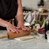 A Woman Making Puff Pastry Dough. For Meat Pies, square royalty free stock photography