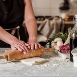 A Woman Making Puff Pastry Dough. For Meat Pies, square stock images