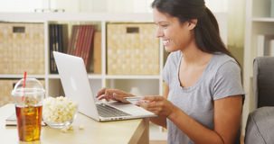 Woman making a purchase online Stock Photos