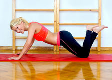 Woman making push up Stock Photo
