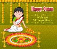Woman making rangoli for Indian festival, Onam Stock Image