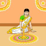 Woman making rangoli for Indian festival Royalty Free Stock Photo
