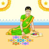 Woman making rangoli for Indian festival Royalty Free Stock Photography
