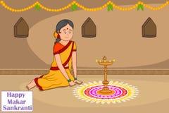 Woman making rangoli for Makar Sankranti Stock Images