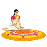 Woman making rangoli for onam Stock Photos